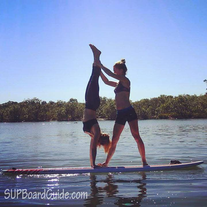 Handstand on a paddle board