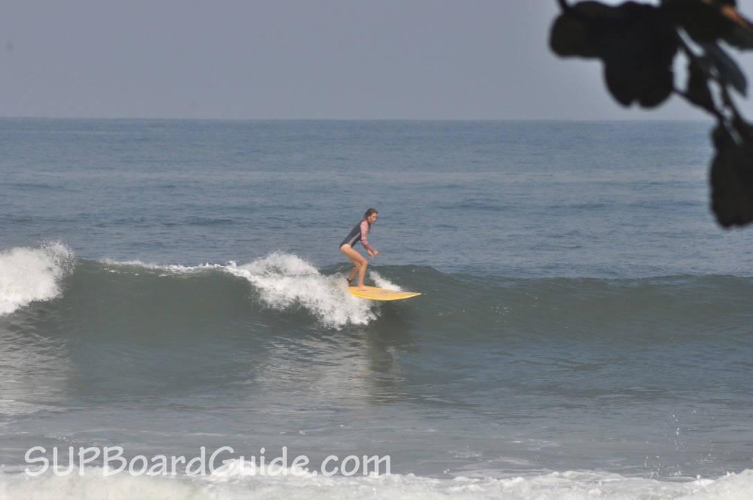 Longboard surfing Bali