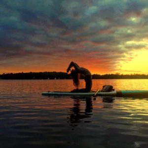 Another SUP Yoga practitioner doing her morning routine.