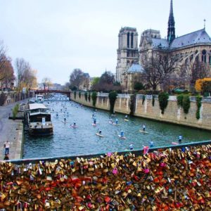 love locks and paddleboards take center stage in Paris, another perfect photo for SUP enthusiasts.