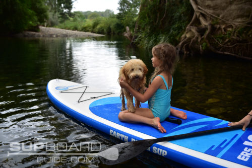 Kid And Dog On Inflatable SUP