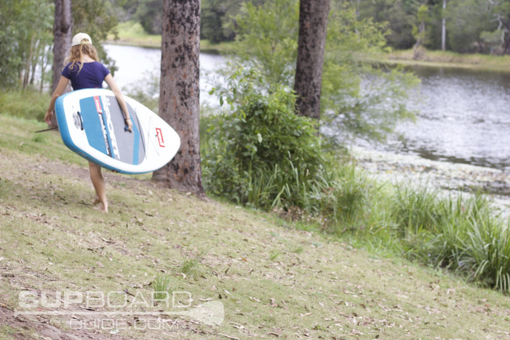 Taking Paddle Board To Water
