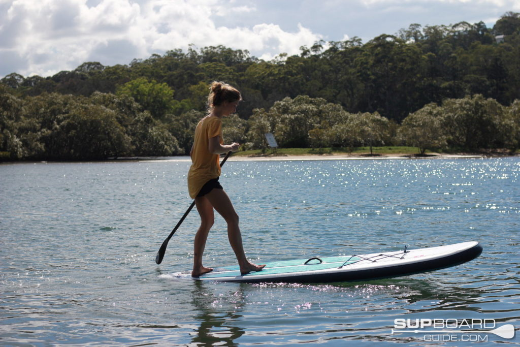 Manuevering SUP on water